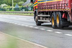 Curtain side truck on uk motorway in fast motion.  stock photos