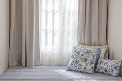 Curtain and sofa bed Royalty Free Stock Image
