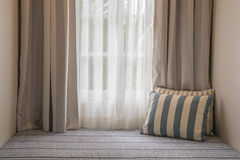 Curtain and sofa bed Stock Image