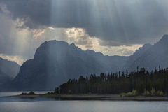 Curtain of sun rays over Teton Mountains, Jackson Hole, Wyoming. Stock Images