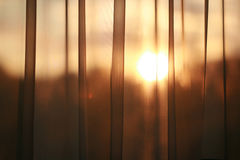 Curtain with sun. Sun shining through curtain Stock Photos