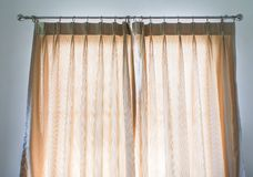 Beige curtain in master bedroom Stock Images