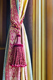 Curtain tassel for interior decoration.  Royalty Free Stock Photo