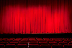 Curtain in theatre. A red curtain in an empty theatre Royalty Free Stock Photography
