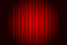 Curtain from the theatre with a spotlight Royalty Free Stock Images