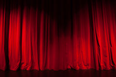 Curtain from the theatre with a spotlight Stock Image