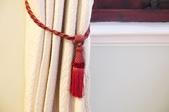 Curtain tie back fastener red detail. Uk stock photography
