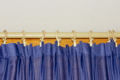 Curtain to the window. Blue curtain on the window Royalty Free Stock Image
