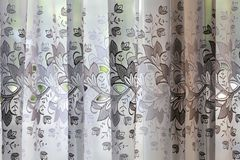 Curtain of transparent tulle. Sheer curtain window tulle. Curtain of transparent tulle. Sheer curtain window tulle royalty free stock photos