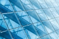 Curtain wall made of blue toned glass and steel Royalty Free Stock Photos