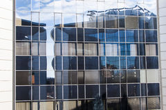 Curtain wall. Reflections on the glass curtain wall of a building Stock Photo
