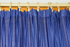 Curtain on the window. Blue curtain on the window Royalty Free Stock Photos