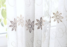 Curtain with a pattern for the interior. And comfort in the room Royalty Free Stock Photos