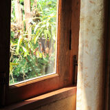 Curtain at the window in morning Royalty Free Stock Photography
