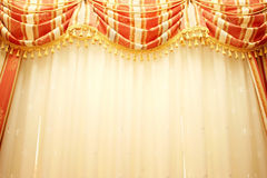 Curtains. Luxurious red and yellow  curtains as a background Royalty Free Stock Photography