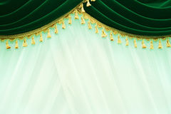 Curtains. Picture of luxurious green curtains Royalty Free Stock Images