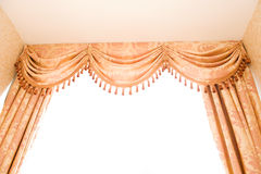 Curtains. Brown velvet theater curtains in a room over white background Stock Photos