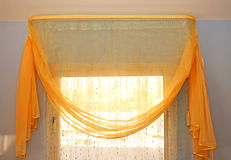 Curtains. Yellow transparent curtains at the window Royalty Free Stock Images