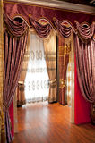 Curtains. A view of luxurious drapes and curtains stock photo