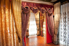 Curtains. A view of luxurious drapes and curtains royalty free stock image
