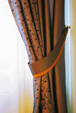Curtains. Luxury curtains Are shined by light from a window Stock Photos