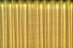 Curtains. Backdrop of yellow curtains with heavy texture royalty free stock photo