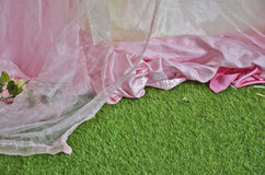 Curtains with artificial grass floor Royalty Free Stock Image