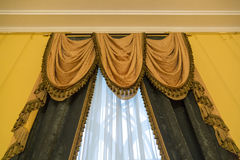 Curtains as an element of the window decoration. Heavy curtains made of thick fabric. Window decoration idea stock photo