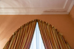 Curtains as an element of the window decoration. Heavy curtains made of thick fabric. Window decoration idea royalty free stock image