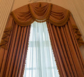 Curtains as an element of the window decoration. Heavy curtains made of thick fabric. Window decoration idea stock images