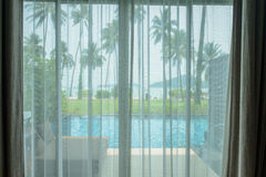 Curtains with beach view Stock Photos