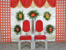 Curtains with chairs. Detail of curtains and chairs decorative flowers royalty free stock photography