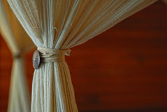 Curtains detail. Blurred wooden background Stock Photos