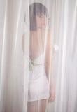 Through the Curtains Stock Photo