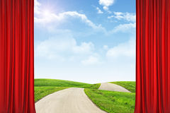 Curtains and landscape under blue sky with road Royalty Free Stock Images