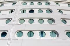 Curtains Over Ship Portholes Royalty Free Stock Image