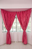 Curtains over window Stock Photos