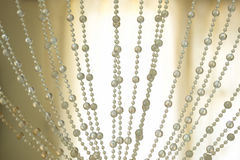 Curtains pearls decoration and backlit background. Gorgeous curtains pearls decoration and backlit background Stock Photos
