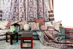 Curtains and pillows. Interior with bunch of pillows and floral curtains Royalty Free Stock Image