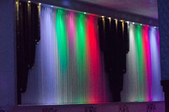 Curtains in the room celebrations highlighted by different colors: blue, red, green, purple Royalty Free Stock Photo
