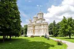 Curtea de Arges monastery with its amazing green yard. royalty free stock image