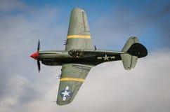 Curtiss P40 Warhawk. In flight against blue sky Stock Photos