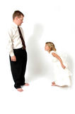 Curtsy. A gesture of respect or reverence made chiefly by women by bending the knees with one foot forward and lowering the body. Little girl shows her dad good Stock Images