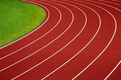 Curva corriente de la pista del atletismo Foto de archivo
