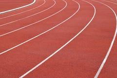 Curva corriente de la pista del estadio del atletismo Imagen de archivo