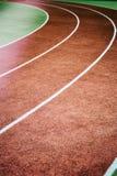 Curva da pista de atletismo Fotos de Stock Royalty Free