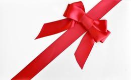Curva e fita vermelhas do Natal imagens de stock royalty free