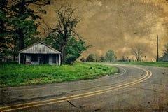 Curva en la gasolinera abandonada camino Imagen de archivo libre de regalías