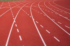 Curva na pista de atletismo Fotos de Stock