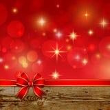 Curva vermelha da fita com a decoração do Natal do bokeh ilustração stock